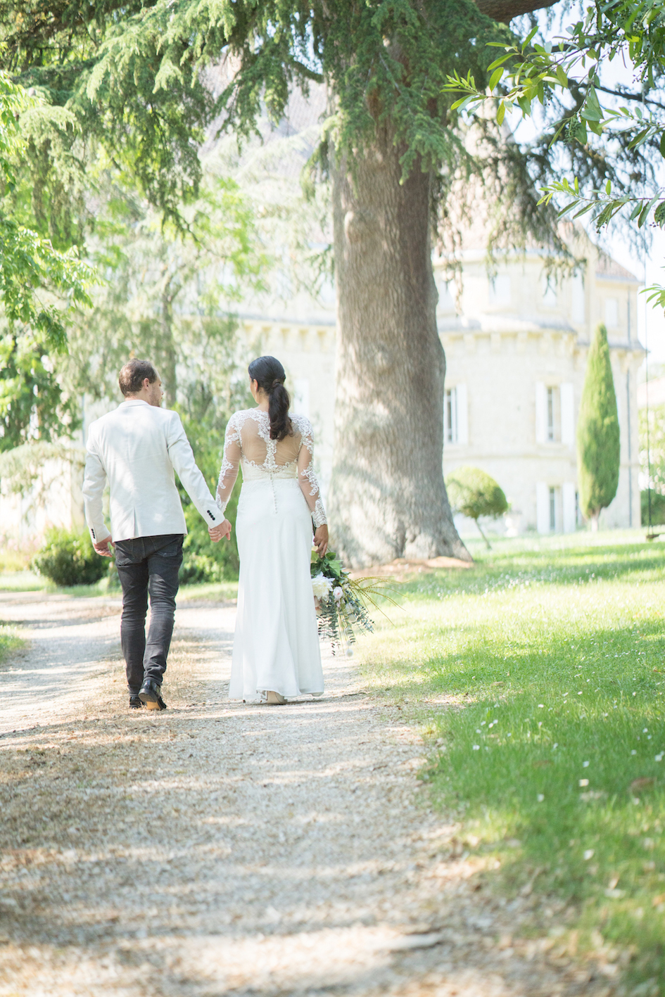 planning a wedding in france - bride and groom holding hands