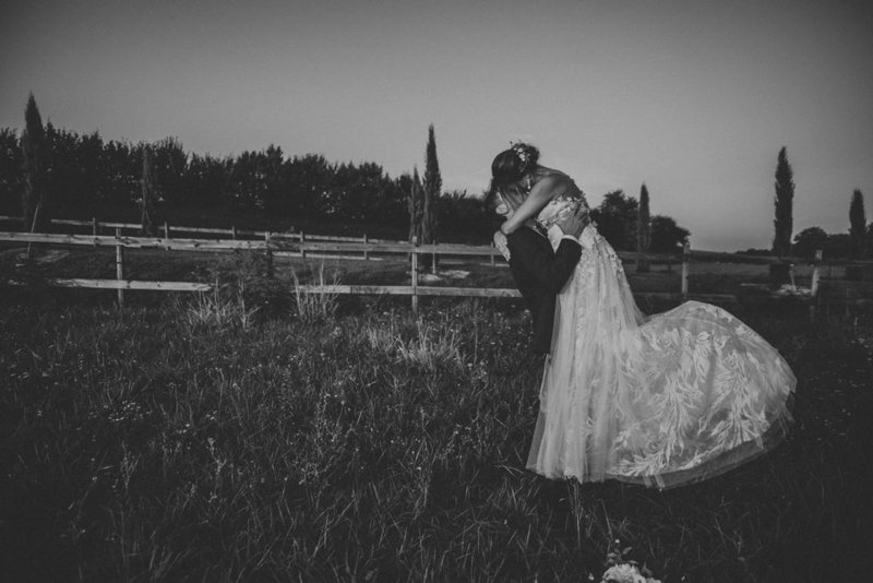 bride and groom embracing in secluded location